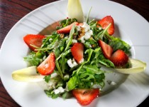 Endive, goat cheese, and strawberry salad with pine nuts