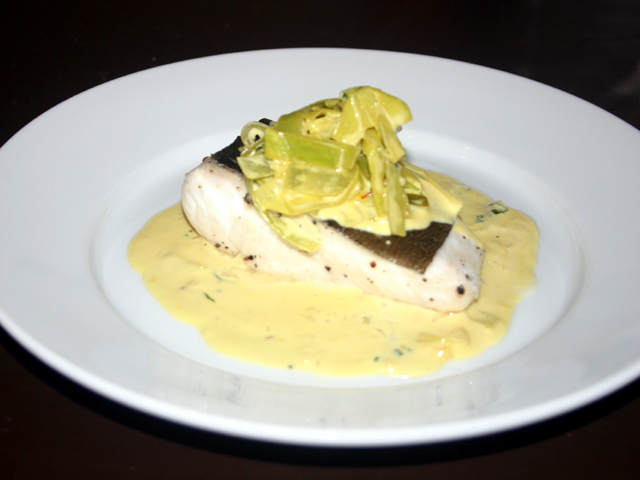 Poached halibut with creamy white wine and tarragon sauce ...