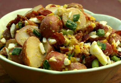Hot potato salad with bacon speck